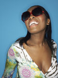 Closeup of an African American Woman In Large Sunglasses Laughin Royalty Free Stock Photos
