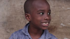 Closeup of African boy`s face. Close up of smiling little african boy face sitting stock video footage