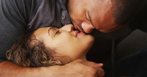 Closeup of African boyfriend kissing his girlfriend Stock Images