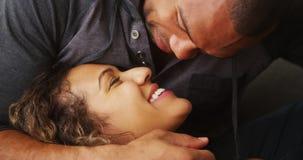 Closeup of African boyfriend kissing his girlfriend Stock Photos