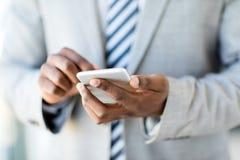 Closeup african man cell phone Stock Photography