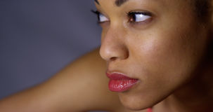 Closeup of african woman looking away from camera Stock Photo