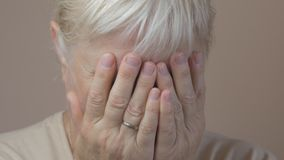 Woman crying. Closeup of aged woman crying stock video