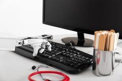 Closeup of an ai robotic hand, using a keyboard Stock Image
