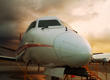 Closeup of aircraft at night. Closeup of parked airplane at night Royalty Free Stock Images