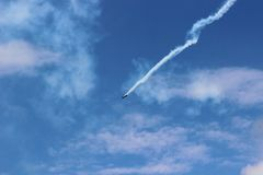 Closeup on airplane contrail against clear blue sky Stock Photos
