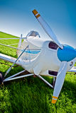 Closeup airplane on the field Royalty Free Stock Images