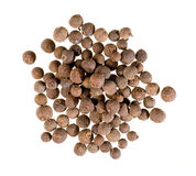 Closeup of allspice. Isolated on white royalty free stock image