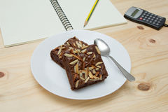 Closeup almond brownie crispy. On wooden table Royalty Free Stock Photography
