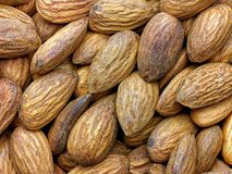 Closeup almonds heap background stock photo