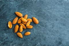 Closeup on almonds on stone substrate Stock Photography