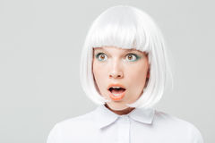 Closeup of amazed pretty young woman with mouth opened Royalty Free Stock Photography
