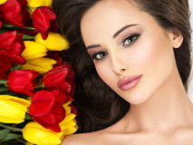 Closeup amazing beauty  face of the young woman with flowers. Royalty Free Stock Images