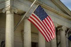 Closeup of an American flag hanging on a sunny day stock image