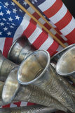 Closeup of American flags with blowing horns Royalty Free Stock Photos