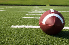 Closeup of American Football on Field. With yard lines Stock Photography
