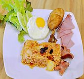 Closeup of American Fried Rice. Asian food, Thai food, American Fried Rice with cucumber, chicken, ham and sausage on white plate on wooden background royalty free stock photo