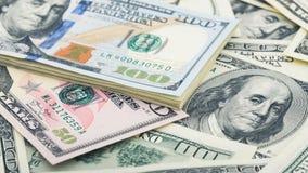 Closeup American money dollar bill. Many US 100 banknote royalty free stock photos