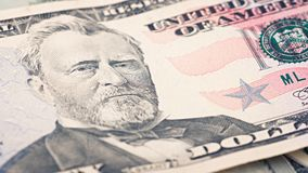 Closeup American money fifty dollar bill. Ulysses Grant portrait, us 50 dollar banknote fragment macro.  royalty free stock photo