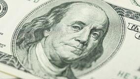 Closeup American money hundred dollar bill. Benjamin Franklin portrait, us 100 dollar banknote fragment macro.  Royalty Free Stock Photo