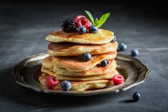 Closeup of american pancakes with maple syrup. On dark table stock photos
