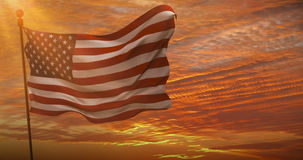 Closeup of american USA flag waving, stars and stripes, united states of america, at sunset, with sun rays stock footage