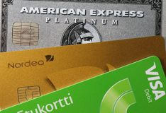Closeup of Amex Platinum, MasterCard Gold and Visa Debit. Closeup of American Express Platinum, MasterCard Gold and Visa Debit card together. Symbols of wealth royalty free stock photos