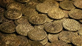 Gold Doubloons Pile Rotating. Closeup of ancient gold coins rotating stock video footage