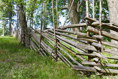 Closeup of ancient wooden fence. In summer Royalty Free Stock Photography