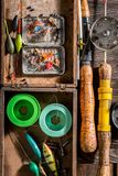 Closeup of angler equipment with fishing rod and lures. Retro style royalty free stock photography