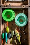 Closeup of angler equipment with floats, hooks and rods. Retro style stock images