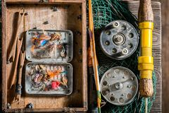 Closeup of angler equipment with hooks and rods. Retro style stock images