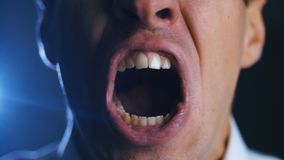 Closeup angry businessman screaming. Aggressive boss threatens violence. Stress at work. Close-up angry businessman screaming. Aggressive boss threatens stock video