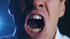 Closeup angry businessman screaming. Aggressive boss threatens violence. Stress at work. Close-up angry businessman screaming. Aggressive boss threatens stock video footage