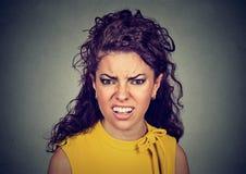 Closeup of an angry furious woman Stock Image