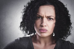 Closeup of an angry girl being mad. Stock Images