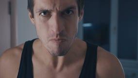 Close-up of angry man screaming at home. Closeup of angry man screaming at home stock footage