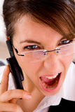 Closeup of angry young female lawyer on the phone Royalty Free Stock Images