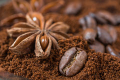 Closeup of anise and  coffee beans with roasted coffee heap Stock Images