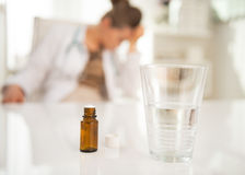 Closeup on antidepressant on table and doctor woma Royalty Free Stock Photo