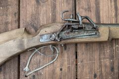 Closeup of antique firearm. Close-up. On wooden background royalty free stock images