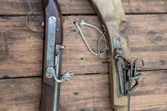 Closeup of antique firearm. Close-up. On wooden background stock images