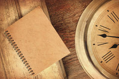 Closeup antique old style clock and notebook Royalty Free Stock Photos