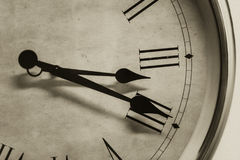 Closeup antique old style clock time roman hour number vintage color tone Royalty Free Stock Photos