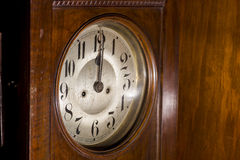 Closeup of an antique pendulum clock Stock Photography