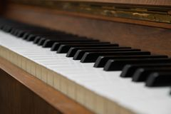 Closeup of antique piano keys. Closeup of old piano keyboard stock photography