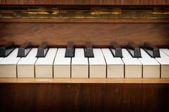 Closeup of antique piano keys. Closeup of old piano keyboard royalty free stock photo