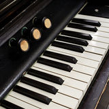 Closeup of antique piano keys and wood grain Royalty Free Stock Photography