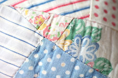 Closeup of antique quilt Stock Photos