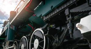 Closeup antique vintage train locomotive. Old steam engine locomotive. Black locomotive. History industry. Historic steam train. Old transportation vehicle royalty free stock photo